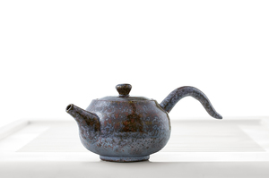 Round Teapot With Mottled Maroon Glaze