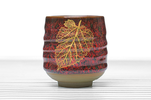 Crimson Glazed Cylindrical Tea Bowl With Golden Leaf Pattern
